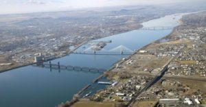 An aerial view of the Columbia River and the cable and blue bridges that span it and link the cities of Kennewick and Pasco in Washington state. Scientific models predict that rising temperatures will reduce the snowpack and glacier mass in nearby mountains, resulting in less water for the 1,243-mile-long Columbia River. That could mean less fish and damage to the riverÕs ability to churn out the hydro-power thatÕs worth billions of the dollars to the U.S. and Canada. (Tri-City Herald/MCT)
